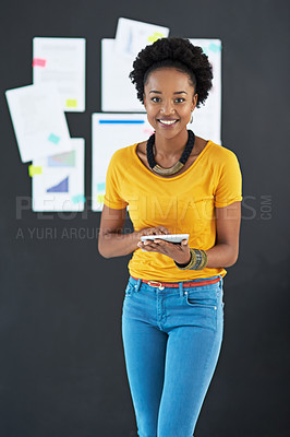 Buy stock photo Shot of a young creative businesswoman in her office