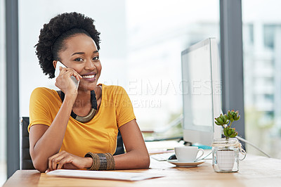 Buy stock photo Cropped portrait of a young designer talking on her cellphone in her office