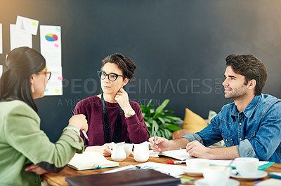 Buy stock photo Cropped shot of a group of young creatives having a meeting in a modern office