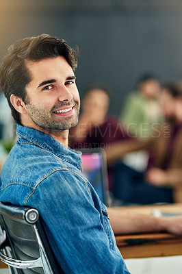 Buy stock photo Portrait of a young designer sitting in a modern office