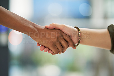 Buy stock photo Cropped shot of two unidentifiable businesspeople shaking hands