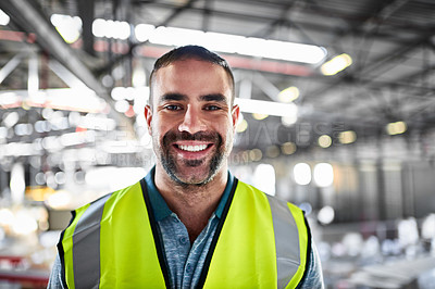 Buy stock photo Portrait of a warehouse worker standing in a large warehouse