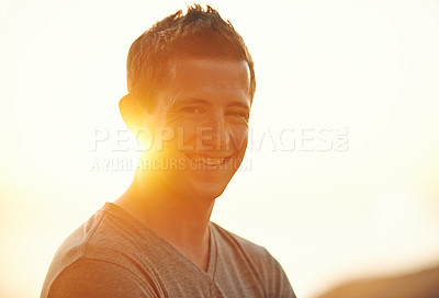 Buy stock photo Portrait of a happy young man enjoying a day outdoors