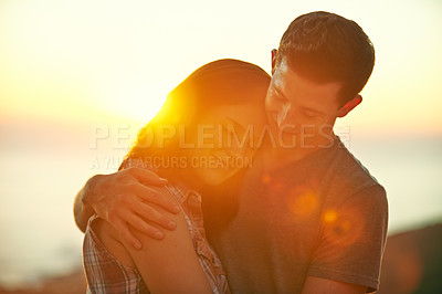 Buy stock photo Shot of a happy young couple embracing outdoors