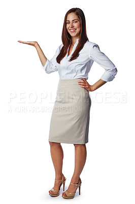 Buy stock photo Studio portrait of a confident young businesswoman showing you copyspace against a white background