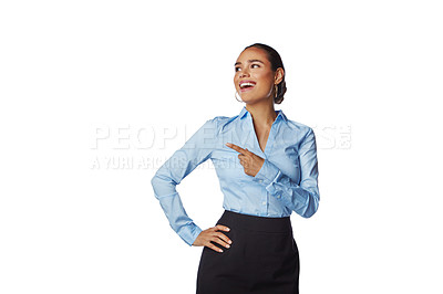Buy stock photo Studio shot of a confident young businesswoman pointing towards copy space against a white background