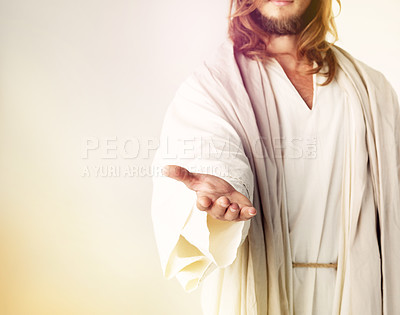 Buy stock photo Cropped studio shot of Jesus Christ extending his arm in assistance