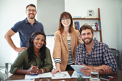 Buy stock photo Portrait of a group of creative businesspeople working together on something on a tablet