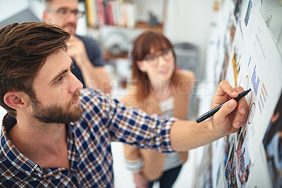 Buy stock photo Shot of creative colleagues working together in their office