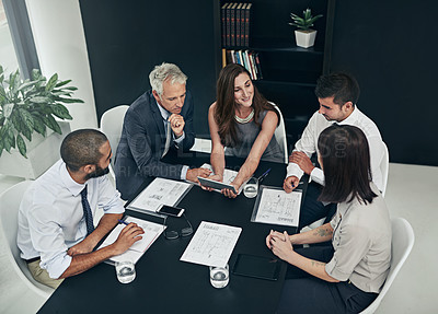 Buy stock photo High angle shot of a group of businesspeople meeting in the boardroom