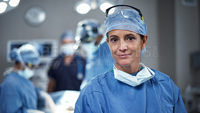 Buy stock photo Portrait of a surgeon looking happy in an operating room