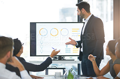 Buy stock photo Cropped shot of a businessman giving a presentation in the boardroom