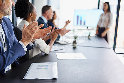 Buy stock photo Cropped shot of businesspeople applauding a colleague's presentation during a boardroom meeting