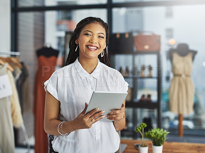 Buy stock photo Cropped portrait of a young business owner using her tablet while standing in her store