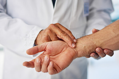 Buy stock photo Cropped shot of a doctor taking a patient's pulse