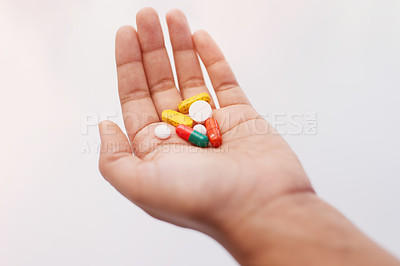 Buy stock photo Cropped shot of a hand holding an assortment of medication