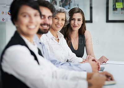 Buy stock photo Portrait of a group of businesspeople sitting together in a modern office