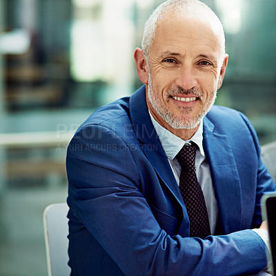 Buy stock photo Cropped portrait of a smiling businessman in his office