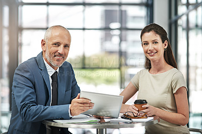 Buy stock photo Portrait of two businesspeople working together on a digital tablet in a modern office