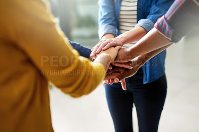 Buy stock photo Closeup shot of a group of businesspeople joining their hands together in unity