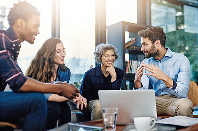 Buy stock photo Cropped shot of a group of creatives having a meeting in a modern office