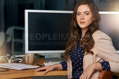 Buy stock photo Portrait of a young businesswoman sitting at a desk in a modern office