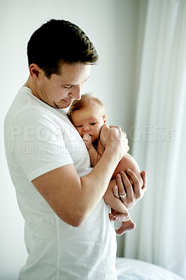 Buy stock photo Cropped shot of a father holding his young baby