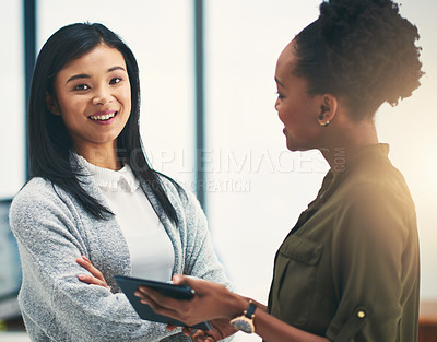 Buy stock photo Portrait of young creative having a discussion with a colleague in an office