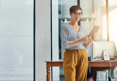 Buy stock photo Portrait of a young creative working on a digital tablet in an office
