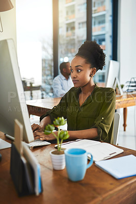 Buy stock photo Cropped shot of a businesswoman working on her computer in the office