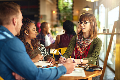 Buy stock photo Shot of a group of coworkers having a meeting around a table
