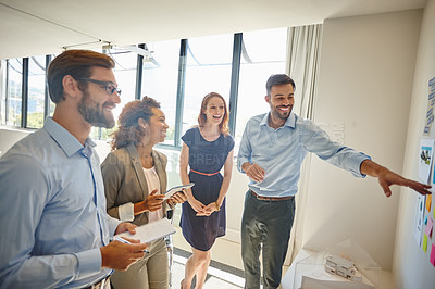 Buy stock photo Shot of a group of colleagues having a brainstorming session at work