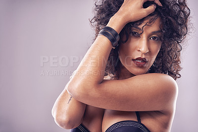 Buy stock photo Cropped shot of a sexy young woman posing in the studio