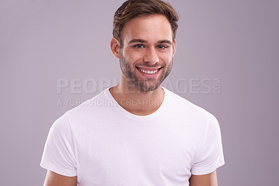 Buy stock photo Portrait of a handsome young man posing in the studio