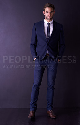 Buy stock photo Full length portrait of a stylish young businessman posing in the studio