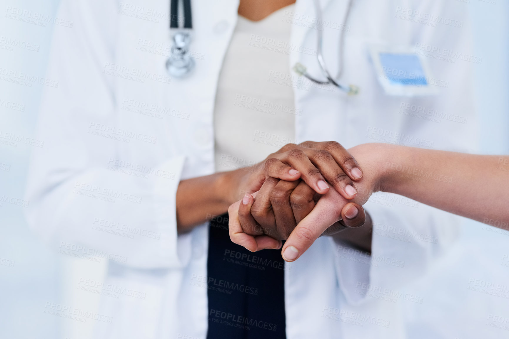 Buy stock photo Cropped shot of a female doctor consoling a patient