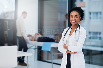 Buy stock photo Cropped portrait of a female doctor standing in her office with patients in the background