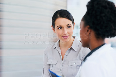 Buy stock photo Cropped shot of a female doctor talking to a patient in the hospital