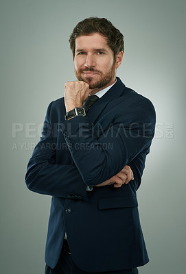 Buy stock photo Studio shot of a young businessman isolated against a gray background