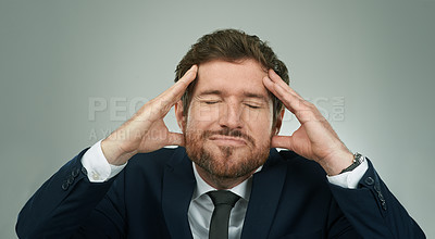 Buy stock photo Studio shot of a stressed out businessman standing with his hands on his head against a grey background