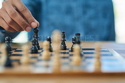 Buy stock photo Shot of an unidentifiable man moving a chess piece