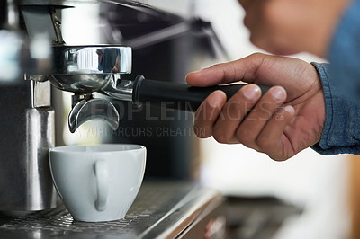 Buy stock photo Cropped shot of a barista making a cup of coffee