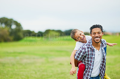 Buy stock photo Portrait of a father and son enjoying a day outside together