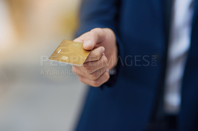 Buy stock photo Cropped shot of an unrecognizable businessman holding out a credit card