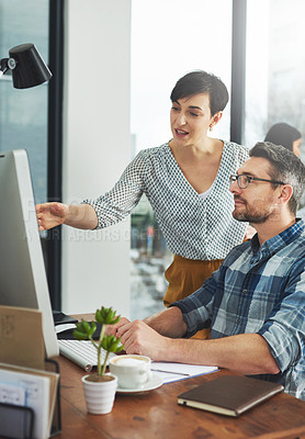 Buy stock photo Cropped shot of colleagues working together on a computer in a modern office