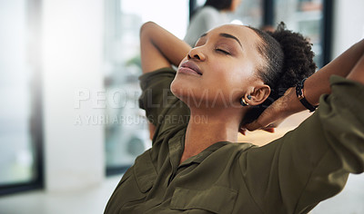 Buy stock photo Cropped shot of a young businesswoman taking a break at her desk