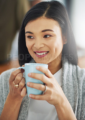 Buy stock photo Shot of a young businesswoman enjoying a cup of coffee