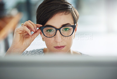 Buy stock photo Cropped shot of a young businesswoman working on a computer in an office