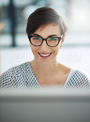 Buy stock photo Portrait of a young businesswoman working on a computer in an office