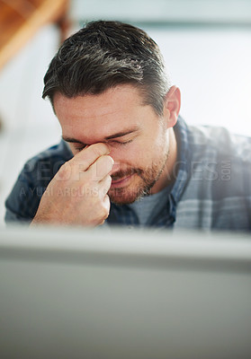 Buy stock photo Cropped shot of a mature businessman looking stressed out at his office desk